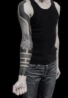 Creative heavy black tattoo sleeve -- useful for cover-ups
