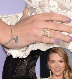 "It might look like a cross, but Scarlett's wrist tattoo is actually a bracelet with ""I Heart NYC"" as a charm.  Source: Getty"