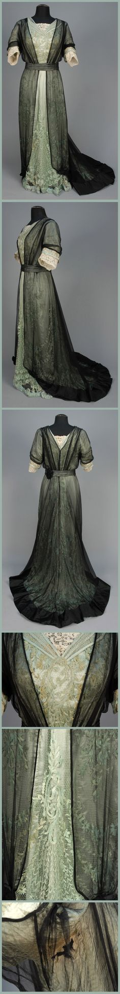 ~TRAINED LACE and SILK GOWN, c. 1908~ One-piece celadon floral embroidered net over satin, having bodice and short sleeve trimmed in cream needle lace, all layered under black chiffon open at front and having pleated sash with black satin medallion and satin hem band. B-38, W-28, L 54-68. (Silk torn and stained under arms, some browning to lace on bodice and at hem) Whitaker Auctions Edwardian Era Fashion, 1900s Fashion, Edwardian Dress, Vintage Fashion, Historical Costume, Historical Clothing, Vintage Dresses, Vintage Outfits, Vintage Clothing
