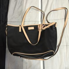 Coach 100% Authentic cross body Like new 100% authentic coach crossbody bag which can be converted to a small tote bag. Straps are removable. Color is black with beige trimming. Coach Bags Crossbody Bags