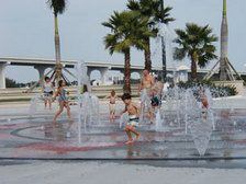The splash park for the kids and the beautiful dock area for the adults.