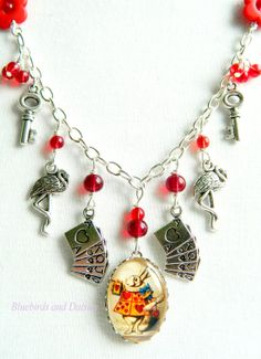Alice in Wonderland Charm Necklace by Bluebirdsanddaisies on Etsy, £11.00