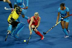 RIO DE JANEIRO, BRAZIL - AUGUST 08: Savita Savita #11 and Renuka Yadav #24 of India defend against Alex Danson #15 of Great Britain for a shot on goal during a Women's Pool B match on Day 3 of the Rio 2016 Olympic Games at the Olympic Hockey Centre on August 8, 2016 in Rio de Janeiro, Brazil. (Photo by Sean M. Haffey/Getty Images)