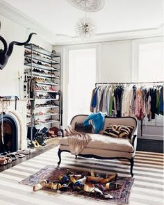 Jenna Lyons has the best closet--love the settee.
