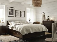 A small bedroom furnished with a brown bed combined with brown chest of drawers and bedside tables.