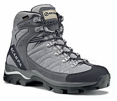 Scarpa Kailash Gore-Tex walking boots. My wife used these to walk the John Muir Trail (California) in 2011. Light and comfortable. She loved them.