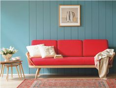 red sofa, blue wall