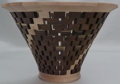 "Open segmented vessel containing 49 pieces of Birch & 264 pieces of Walnut. It has a durable food safe finish. It is a beautiful piece of art & can be used as a vase with a glass insert. It would enhance a table or mantel. It is 11.75"" dia x 7.5""H"