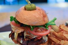 Brandy Burger Grass-fed natural beef topped w/chipotle cheddar, fried red onion straws, organic field greens, tomatoes & house-made brandy sauce served on a brioche bun, choice of bacon