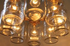 Mason Jar Chandelier - Mason Jar Light - WAGON WHEEL - Industrial Swag - Handcrafted Upcycled BootsNGus Hanging Pendant Lighting Fixture. $200.00, via Etsy.