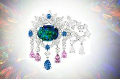 Van Cleef&Arpels' poetic style interpretation of Scorpio. Brooch in platinum, diamonds, colour sapphire, spinel and a black opal