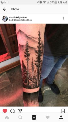 My new tree tattoo with roots in mountain range