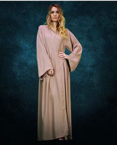 Nude abaya last in stock the price 650 Aed