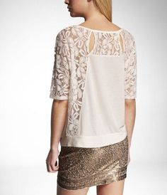 Give them the cold shoulder in a tee that's in love with lace. A sheer floral lace adorns the shoulders and back of this super-soft tee for a look that's ripe for layering.