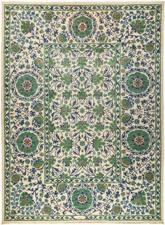 This Suzani is a new, hand-knotted rug in excellent condition.   Inspired by embroidered Suzani textiles from Uzbekistan, this rug features floral motifs in modern palettes and compositions. Hand-knotted of vegetable-dyed wool, the rugs are designed to retain their vibrancy for generations to come.