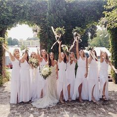 Bouquet tossin' in all white bridesmaid dresses. #mumuweddings