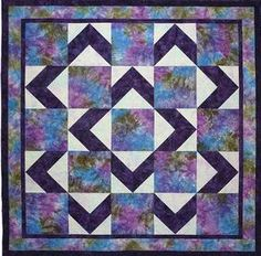 This quilt is easy and the pictures does not do it justice. Good for featuring large prints.