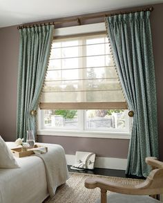 Window treatment...great sheer blind and for more privacy slide those pretty curtains shut.