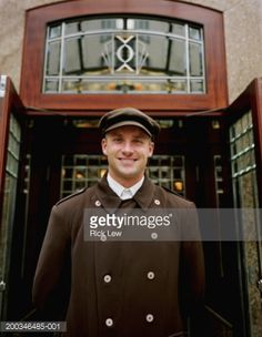 Stock Photo  Hotel doorman standing outside doors portrait  sc 1 st  Pinterest & The doorman is always there to greet you at the Heathman ...