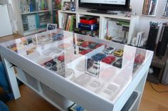 display your car collectibles in style with this table