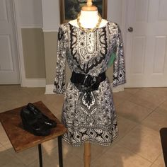 Tunic Black and white tunic 3/4 sleeves. Belt, shoes, necklace not included Brass Candy Dresses Mini