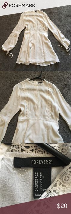 Peasant white womens dress Very Coachella vibey. Sooo super cute, just don't like the way it fits me, never worn excellent condition, ties at the en of sleeves, zips in the back. Questions just comment Forever 21 Dresses Long Sleeve