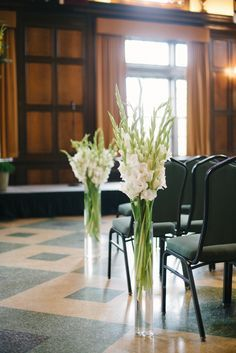 Use tall vases to line the pews, assign 2 people to take them to the reception for the tables