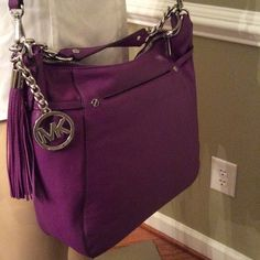 "Special price today limited  silver accent Just a gorgeous purple large leather tote 15.5"" W X 11.0"" H X 4.5 "" D approximate new with tags makes a great gift 2 straps excellent statement purse. This will make a great gift to yourself  Michael Kors Bags Shoulder Bags"