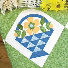 Great tutorial on how to applique curved pieces, such as this basket handle. Detail of Buttercup Baskets by Erin Russek