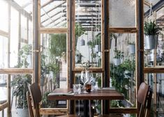 Väkst: A Greenhouse Restaurant in Copenhagen Serre Restaurant, Greenhouse Restaurant, Greenhouse Cafe, Greens Restaurant, Indoor Greenhouse, Restaurant Design, Restaurant Bar, Indoor Garden, Large Greenhouse