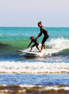 Cute photo. Love that moment when you take your kids out to learn to surf and they get the stoke, then they have that for life From Google+