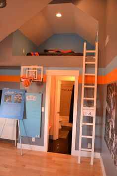 Amazing sports bedroom. Love the bed in the loft! And the hoop!
