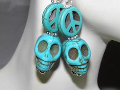 Hand Crafted Day of the Dead Earrings with Blue Turquoise Sugar Skulls, Peace Signs, and Sterling Silver French Style Earring Hooks by MelancholyMind, on Etsy