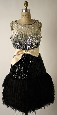 Dress, Evening  Yves Saint Laurent, Paris  (French, founded 1962)  Designer: Yves Saint Laurent (French (born Algeria) Oran 1936–2008 Paris) Date: 1967 Culture: French Medium: silk, plastic, feathers, glass