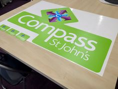 Contour cut repositionable wall graphic for Compass St John's