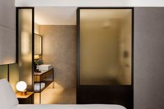 The Warehouse by Asylum | hotel bathroom | frosted glass room divider