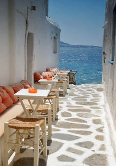 Alley cafe to the sea in Mykonos, Greece.