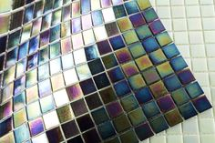 This material consists of small squares of 20x20x4 mm made from glass and pre-mounted on mesh (sheet size: 323x323 mm). They come in two variations: with a pearl effect or coppery gold veins. Both are available in various colours. The mosaics are suitable for, for instance, airports, bathrooms, fireplaces, hospitals, indoor and outdoor walls, swimming pools, etc. Yucca Valley, Sheet Sizes, Glass Material, Airports, Hospitals, Outdoor Walls, Mosaic Glass, Fireplaces, Mosaics