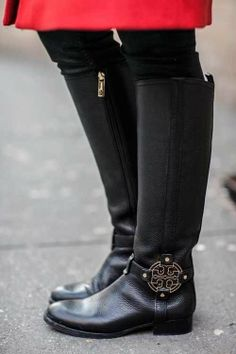 Black Tory Burch riding boots - i really don't need my kid to see these. she'd knock me down for them.