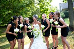 black dresses,simple white calla lilies for the girls