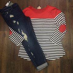 The bright red suede details on this top pop against the classic navy & white stripes! We love this cute top paired with a distressed skinny and white sneakers or a classic laid back look.