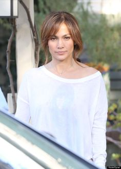jlo bangs but what is on her shirt