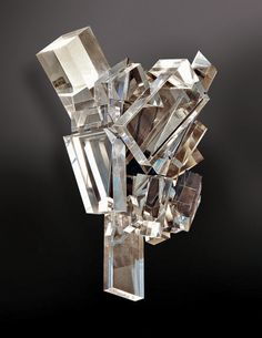 The Ice Crystals sconce, of original acrylic, available only in left-and-right opposing pairs, through Allan Knight