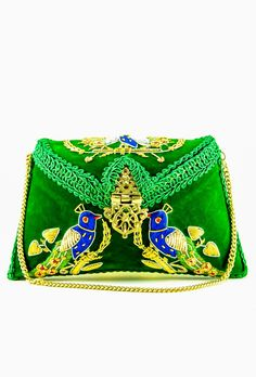 Desi Royale presents royal embroidered peacock clutch bag in intricate handwork and pom pom multicolor tassle to enhance the charm. It is a purse for the women
