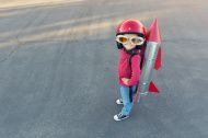 Young boy dressed in a red rocket suit on blacktop stock photo 36932558 - iStock
