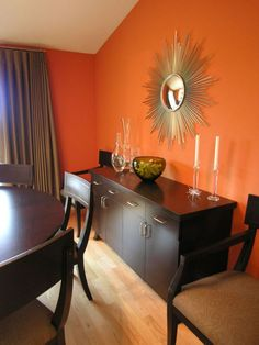 Living Room Ideas Orange Walls orange walls, patterned artwork and light carpets add to the