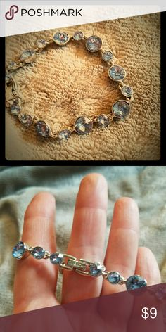 Womens silver color and blue crystal bracelet Brand new and never been worn too Jewelry Bracelets
