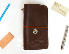 This is our Midori Travelers pure leather Notebook that includes three inserts, small notepads.  All the inner notepads can be easily changed. We will provide dozens of new designs.
