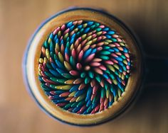 Macro photograph of rainbow toothpicks