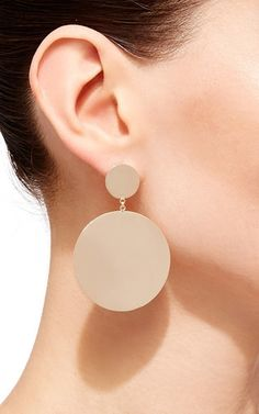 A true object of the designer's minimalist expression, these earrings by **Mateo** embody a sleek and modern aesthetic with pure and precise forms.